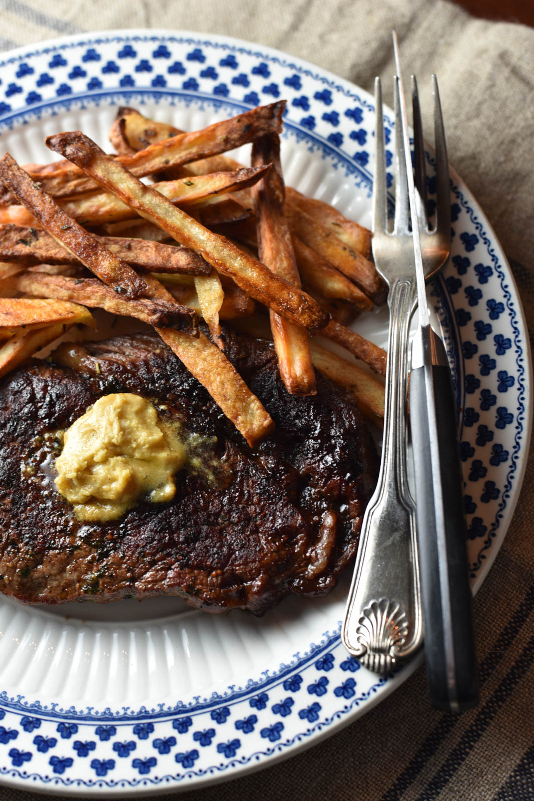 Steak with Mustard Butter and French Fries